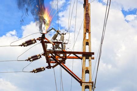Photo pour Power pylon - overloaded electrical circuit causing electrical short  - image libre de droit