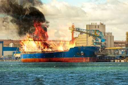Photo for Burning cargo ship in the port. - Royalty Free Image