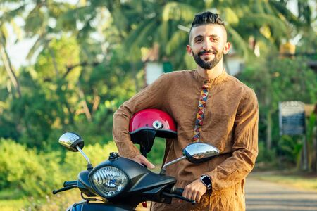 Photo for indian man wear helmet and ready to driving explore india attractions of Goa - Royalty Free Image