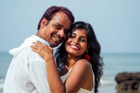 Photo for indian male making proposal with engagement ring and roses to his girlfriend at sea beach.Valentine day at Goa - Royalty Free Image