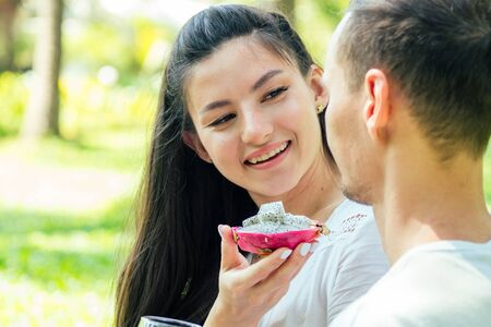 Photo for young indian woman in lace white boho dress having a dating with her boyfriend in summer park - Royalty Free Image