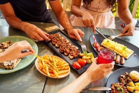 Photo pour Group of friends having breakfast in the restaurant. - image libre de droit