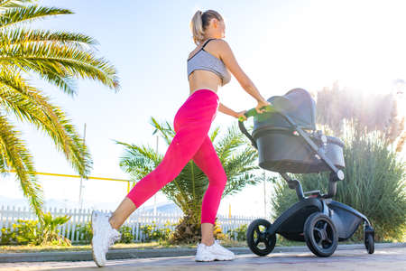 Photo for blonde beautiful woman ready to be the best mother and getting in shape after giving birth in tropics background beach - Royalty Free Image