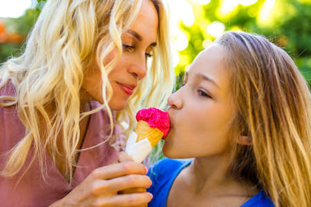 Photo for blonde mom and her cute child in summer beach seaside in tropics - Royalty Free Image