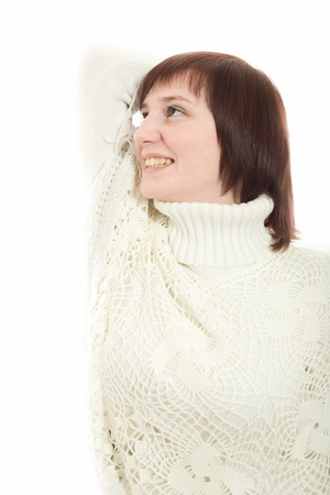 beautiful woman in a white sweater on a white background