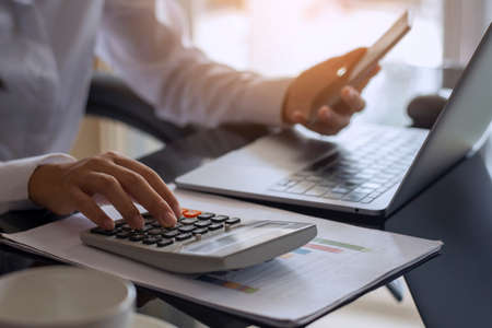 Photo pour Casual business woman hand holdng credit or debit card and using calculator, work on laptop computer for online shopping and payment. e commerce concept. Top view. - image libre de droit