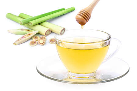 Photo pour Lemongrass tea with honey  isolated on white background. Medical herbal plant concept. - image libre de droit