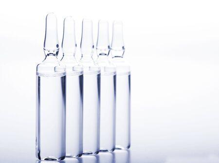 Photo pour Glass medicine ampoules with liquid on white - image libre de droit