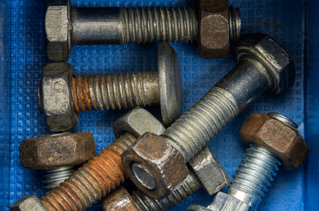 Photo pour Fasteners bolts and nuts in the organizer - image libre de droit