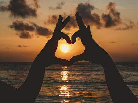 Photo for hands make heart at the sunset - Royalty Free Image