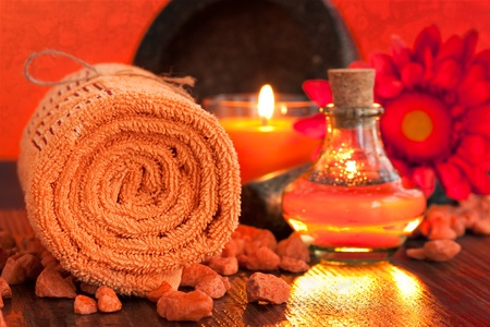 Spa setting  in orange tones  with candles