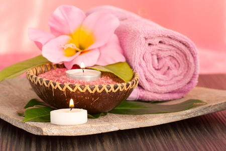 Spa setting  in pink tones with candles