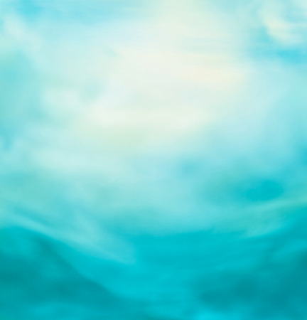 Spring or summer abstract nature background with blue sea and sky. Ocean blur