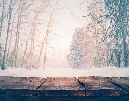 Winter snow landscape with wooden table