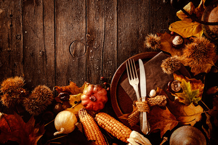 Thanksgiving dinner. Autumn fruit with plate and cutlery. Thanksgiving autumn backgroundの写真素材