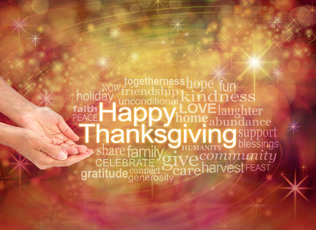 Photo for Have a Happy Thanksgiving - female cupped hands with the word THANKSGIVING to the right surrounded by a word cloud on a warm golden orange sparkling starry celebration background - Royalty Free Image