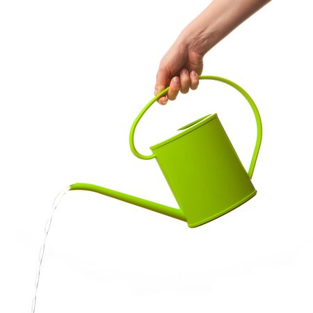 hand holding watering can isolated