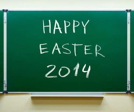 Happy Easter 2014 chalk handwritten on classic blackboard