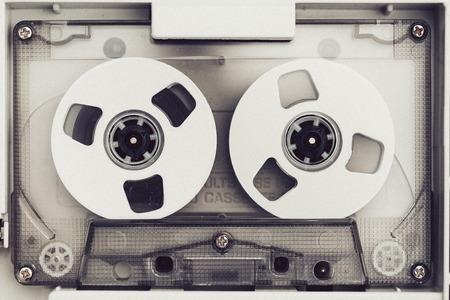 Photo pour vintage audio tape compact cassette, black and white with artistic film noise - image libre de droit