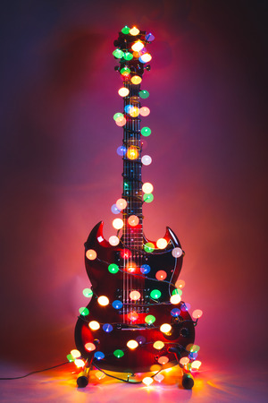 Photo for electric guitar with Christmas garland lights - Royalty Free Image