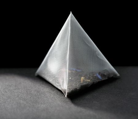 pyramid tea bag on black background