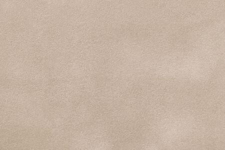 Photo pour Light beige matte background of suede fabric, closeup. Velvet texture of seamless sand leather. - image libre de droit