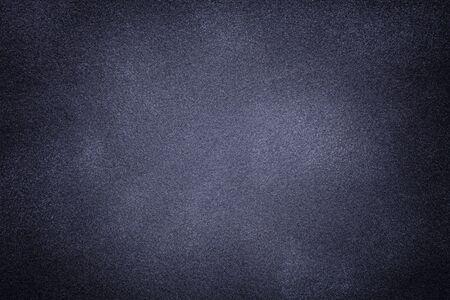 Photo pour Background of dark gray suede fabric closeup. Velvet matt texture of blue nubuck textile with vignette. - image libre de droit