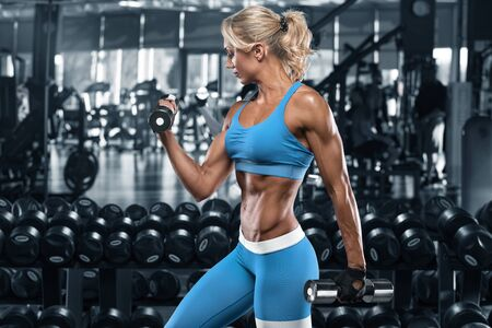 Photo for Sexy athletic girl working out in gym. Fitness woman doing exercise - Royalty Free Image