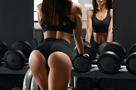 Photo for Sexy athletic girl with beautiful glutes workout in gym. Beautiful butt in thong. Fitness woman doing exercise - Royalty Free Image