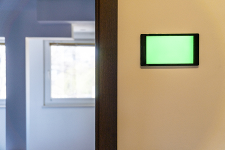 Photo pour Home automation concept. Device with blank screen hanging on a wall. - image libre de droit