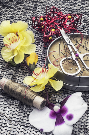sewing tools and floral decorations