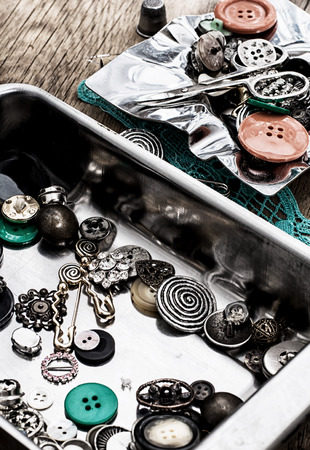 buttons and sewing tools