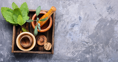 Sage,healing herbs in wooden box on table.Herbal medicine.Healing herbs