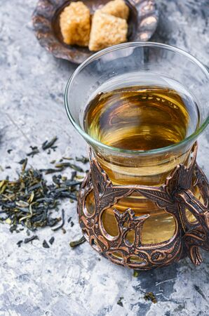 Photo pour Eastern tea in traditional glasse.Eastern tea concept - image libre de droit