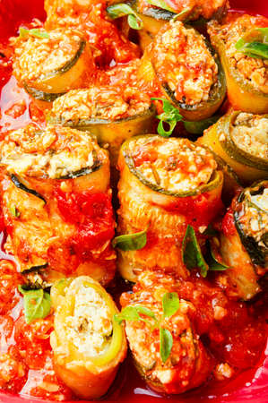 Photo pour Baked zucchini or eggplant stuffed with cheese - image libre de droit
