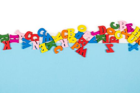 Photo pour Row of multicolored letters isolated on a white background. Copy space. Frame. - image libre de droit