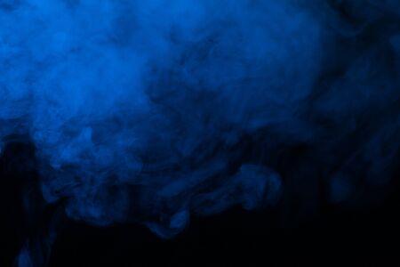 Photo pour Blue steam on a black background. Copy space. - image libre de droit