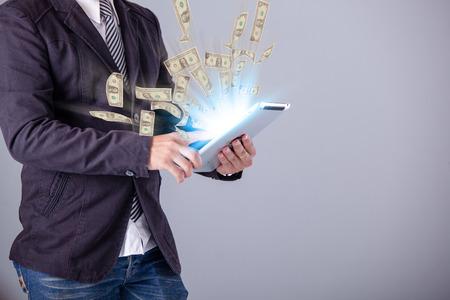 Photo pour business man using a laptop building online business making money dollar bills - image libre de droit
