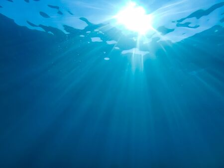 Photo pour abstract underwater background with sun beam and water ripple - image libre de droit