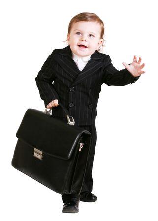 Photo pour Little boy with suitcase over white - image libre de droit