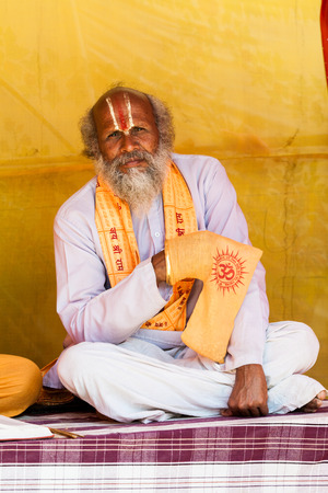 ALLAHABAD, INDIA - FEB 13 - A Hindu priest chanting mantras on prayer beads during the festival of Kumbha Mela on February 13th 2013 at Allahabad, India.