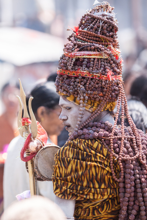 KEDARNATH, INDIA - JUNE 1st 2013 - A naga sadhu at the shrine of Kedarnath in North India.