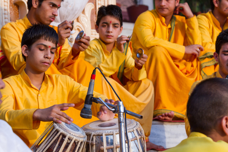 India, Rishikesh - 15th May 2013 - A group of young boys sing Hindu bhajans in praise of the gods - Rishikesh, India.