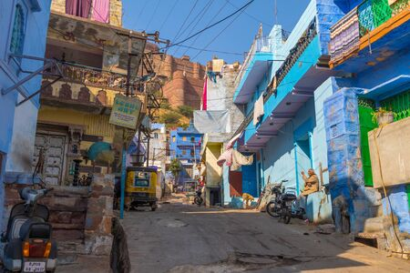 Jodhpur, India,16th January 2017 - A sidestreet in Jodhpur with the Mehrangarh Fort in the background.