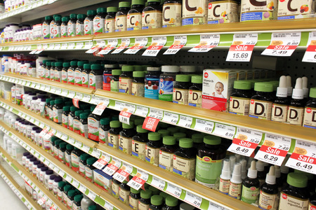 Photo pour Different types of vitamins and supplements on shelves in a pharmacy - image libre de droit