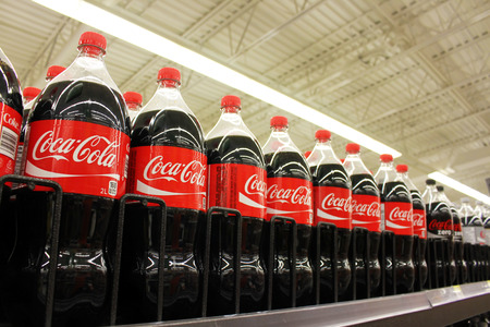 Coca Cola products on display in a grocery store