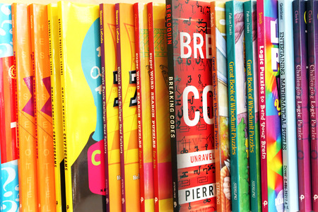 Close up of a variety of children books on display in a book store