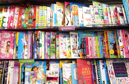 Children drawing books on shelves in a book store
