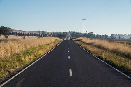 Two lane rural road in Dookie in the Goulburn Valley, Australia