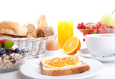 breakfast table with toast and orange marmelade isolated on white background